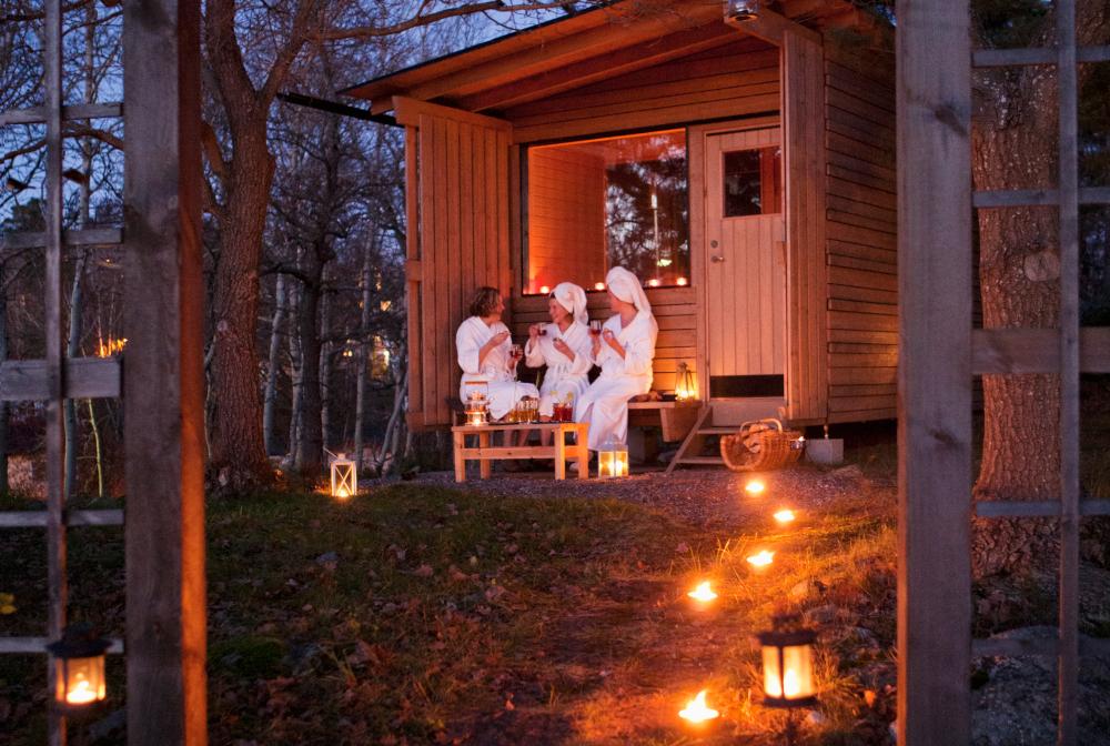 Sweden, Stockholm, Nacka, Terrassvagen 1, Women Sitting Outside Sauna