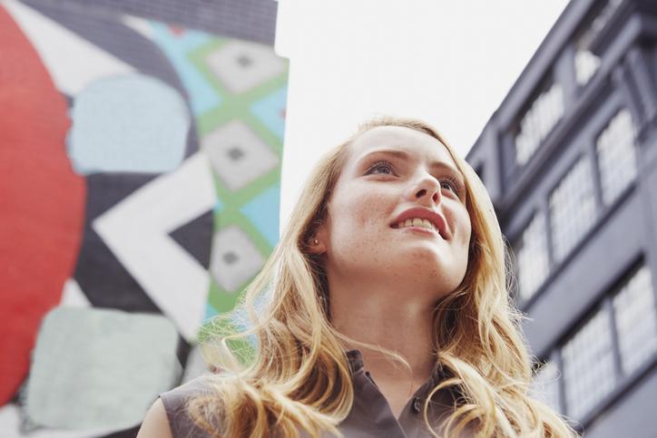 Women Smiling, Wall Art In Background, London, Uk