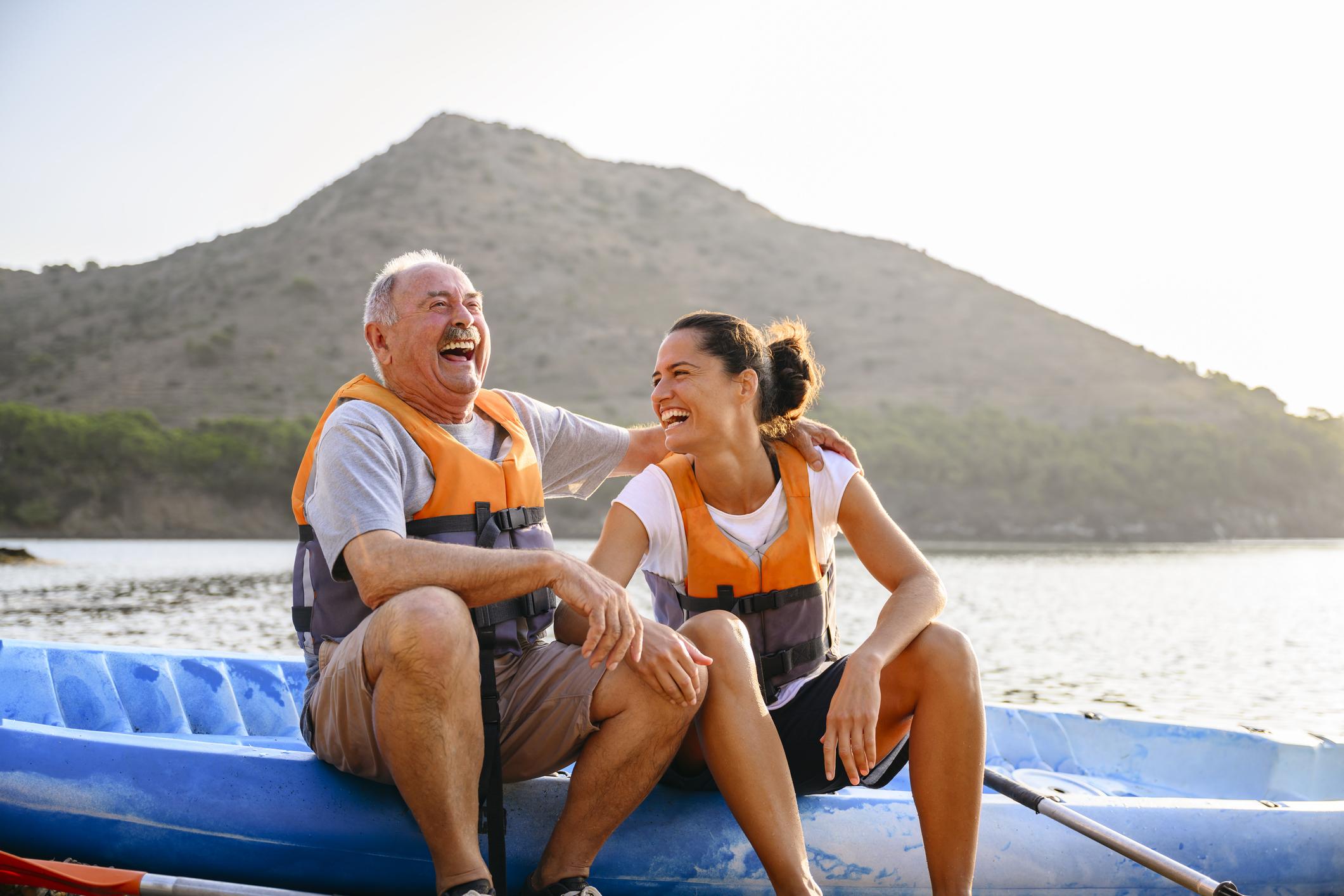 Spanish Male And Female Enjoying Early Morning Kayaking